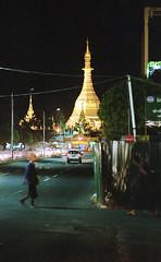 Sule's Night ((Jean) Rooble) Tags: ae1 analogic ae1p analog asia 35mm rangoon yangon myanmar ishootfilm istillshootfilm primelens portra canon city v550 burma birmanie bokeh 2015 travel travelphotograph street streetshot pagoda nightshot night nightview nuit