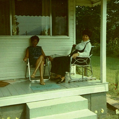 Front Porch (~ Lone Wadi ~) Tags: frontporch blackwomen africanamerican house residence lostphoto retro 1960s unknown