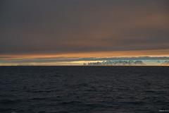 Sunrise behind Graham Land (i-lenticularis) Tags: enroutepetermannisland firstlight grahamlandsunrise k1 tamronsp2875f28 antarcticpeninsula