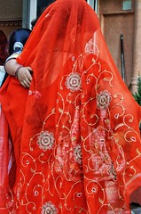 Mother in the red veil (Pejasar) Tags: embroidery detail cloth veil red child mother india