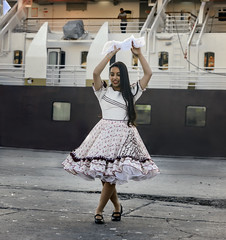 Cueca Dancer at Coquimbo Chile Dock (Tom Kilroy) Tags: chile laserena coquimbo nationalgeographiclinblad nationalgeographic women people females dancing beautiful dress fashion youngadult elegance dancer smiling beauty cheerful outdoors oneperson lifestyles fun
