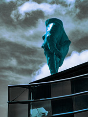 Secretly Giving the Middle Finger (Steve Taylor (Photography)) Tags: hand face art digital sculpture roof window artgallery teal blue glass newzealand nz southisland canterbury christchurch city cloud sky