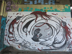 IMG_3942 (Mud Boy) Tags: españa streetart river graffiti sevilla spain guadalquivir mural europe seville andalusia yinyang raven yinandyang 阴阳 陰陽 yīnyáng canaldealfonsoxiii estacióndeautobusesplazadearmas estacionesdeautobuses iberianpeninsulainsouthwesterneurope plazadearmasestacióndeautobusessevilla autobusesplazadearmas puentedelcristodelaexpiración41001sevillaspain spanningtheriverguadalquivirandrepresentsthenaturaloutletofthecitytothealcorandtheprovinceofhuelvawasbuiltin1991 puentecristoexpiracion puentedelcristodelaexpiraciónsevilla urbanbridgeinthecityofsevilla meandrodesanjerónimo