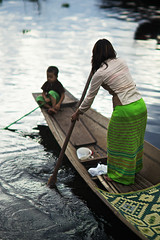 Burmese woman rowing on traditional barque with her little child, Inle Lake, Myanmar (Alex_Saurel) Tags: travel portrait people woman lake detail cute sexy nature water beautiful beauty female children asian boat movement divers scans asia pretty raw day child time outdoor burma altitude femme group culture photojournalism documentary lac style scene clothes bark portraiture transportation type rowing myanmar asie nautical tradition fullframe bateau ethnic position indigenous barque longyi birmanie beaute mignonne portray fullbody birmania vetement estetic ethnique qualite longi ethnie lifescene 35mmprint imagetype photospecs stockcategories pleinformat planart1485 85mmf14za indigene estethique