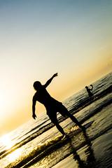 Skimboarding @ Zaandvoort Beach (vnkht) Tags: sunset sunlight black netherlands sunshine silhouette strand lumix 50mm evening raw dusk thenetherlands panasonic f80 skimboarding zandvoort 2012 noordholland lightroom nederlanden skimming northholland skimboarder iso80 zandvoortaanzee zandvoortbeach lx5 dmclx5 lightroom5 gavinkwhite
