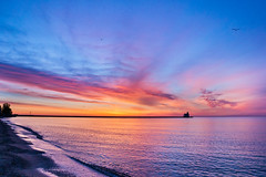 Dreamer's Dawn (PopsDigital) Tags: morning blue light red orange sun lighthouse lake color colour reflection beach water silhouette horizontal wisconsin clouds sunrise landscape harbor pier early earlymorning lakemichigan wi doorcounty calmwater kewaunee kewauneecounty billpevlor popsdigital sonyslta77v
