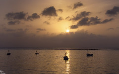 Sunset at Mumbai (kshitij.lawate) Tags: sea sun water clouds landscape boat bombay mumbai seashore hajiali seaface