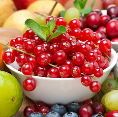 close-up of assorted fresh fruit and berries (cook_inspire) Tags: summer food orange color apple nature kitchen closeup fruit garden dessert wooden juicy healthy mixed mix berry colorful different natural bright market sweet eating juice background seasonal harvest mint bio fresh collection delicious blueberry cranberry health grapes vegetarian pear citrus organic variety diet agriculture kiwi ripe nutrition vitamin redcurrant