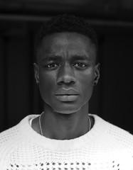 Ebrima (MrGlen) Tags: street light portrait man fashion mono model mood actor drama select
