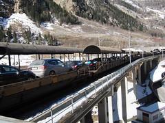 In Switzerland trains take cars thru mountains!