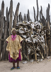 The Queen Of The Okwanyama, Omhedi, Namibia (Eric Lafforgue) Tags: africa vertical fur dead outdoors photography death women day power adult fulllength surreal palace queen spooky deadanimal woodenfence afrika tradition namibia bizarre adultsonly ambo oneperson horned namibie animalskin animalskull senioradult realpeople bantu colorimage onewomanonly lookingatcamera namibe colorpicture animalbone namibi namiibia colourimage africanethnicity 1people indigenousculture lionskin ovambo onlywomen colourpicture     namibya namibio travellocations oshiwambo conceptsandideas    aawambo africantribalculture meekulumwadinohmo okwanyama omhedi namibia11081