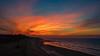 sunset (Colin-47) Tags: sunset red sea orange weather reflections norfolk july explore cc northsea fireinthesky eastcoast walcott fieryred abigfave samsung20mmf28 samsungnx300