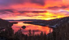 An explosive sunrise at Emerald Bay (Sribha Jain) Tags: laketahoe emeraldbay sunrise clouds california fannetteisland lake reflection winters snow sierras