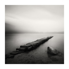 Loch Ard (richieJ 11) Tags: lochard trossachs scotland jetty lake mist mono blackandwhite rock reflection nikon kinlochard