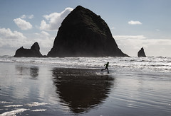 Oh for Joy (ebhenders) Tags: ocean sea stack cannon beach oregon pacific clouds sky surf water reflection running joy