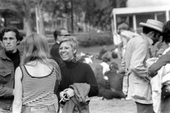 h1-68 09 (ndpa / s. lundeen, archivist) Tags: nick dewolf nickdewolf bw blackwhite photographbynickdewolf film monochrome blackandwhite city summer 1968 1960s 35mm boston massachusetts candid streetphotography citylife people youngpeople park publicgarden bostonpublicgarden man men youngman woman women youngwoman youngwomen cigarette smoker smoking face smile smiling blond blonde shorthair crowd seated sitting onthegrass