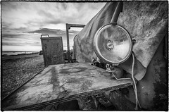 Side of a Seaside Tractor (imperfect visions) Tags: side tractor boats out ocean roundness shininess light contrast rest old rusty machine gary williamson swirly magnolia imperfect visions nikon d7000 wide angle tamron lens water sea waves wet day clouds perspective engine farm boat shine rust texture bnw black white blackandwhite tone cobwebs detail interesting rot decay unused uk england beach lancashire seaside st annes fairhaven blackpool