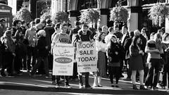 busy day on the Mile 02 (byronv2) Tags: royalmile sunny sunlight spring sunshine oldtown edinburgh edimbourg scotland peoplewatching candid street blackandwhite blackwhite bw monochrome crowd group sale sign booksale