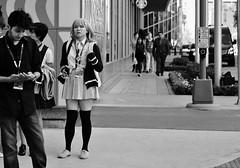 School Girl Cosplay (burnt dirt) Tags: houston texas downtown city town mainstreet street sidewalk streetphotography fujifilm xt1 bw blackandwhite girl woman people person animae cosplay costume uniform matsuri convention blonde asian stockings blackstockings schoolgirl sweater phone cellphone man group crowd standing discoverygreen georgerbrown