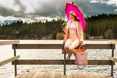 Anna (austinspace) Tags: woman portrait spokane cheney washington spring pink coat umbrella rain flood overflow runoff lake fish dock shore boardwalk