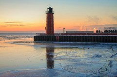 Lake Michigan Dawn (MalaneyStuff) Tags: winter usa lighthouse lake cold water wisconsin sunrise 35mm pier frozen nikon midwest day freezing lakemichigan greatla