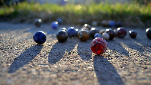 playfulness (59920087@N06), photography tags:  light shadow color play bokeh sidewalk marbles