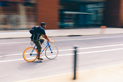 Mobile Placeholder (c. Melon Images) Tags: street city urban man motion philadelphia bike bicycle fuji ride candid philly pan panning 23mm vsco lr5 fujix100s x100s