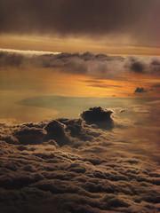 Peaked Clouds (Hayden Watkins) Tags: sunset sky sun clouds flying spain air casio exlim exz70