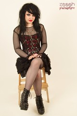 IMG_3003 (Neil Keogh Photography) Tags: red black girl studio necklace chains highheels photoshoot gothic goth skirt corset gothgirl collar leatherjacket tutu buckles laces studs highheeledboots studiophotoshoot bootsmodel dressfishnettop fishnettightshannah