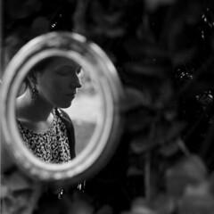 (Esther'90) Tags: portrait blackandwhite bw woman reflection film nature face lights natural medium format leafs emotive