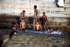 22-353 (ndpa / s. lundeen, archivist) Tags: people india color film boys swimming swim 35mm river children graffiti 22 indian nick steps wash varanasi bathe watersedge bathing 1970s riverbank kashi washing allrightsreserved ganga ganges ghats banaras benares ghat dewolf riversedge uttarpradesh northernindia nickdewolf photographbynickdewolf reel22 thenickdewolffoundation imageuserequestsarewelcomeviaflickrmailornickdewolfphotoarchiveatgmaildotcom