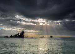 Better Days Ahead John (Beth Wode Photography) Tags: ocean sunset sea seascape canon island beth moretonisland sunrays shipwrecks darkdays wode gloomyskies 5dmarkiii bethwode