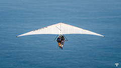 Hang Gliding (Totem REC - CLICK) Tags: action active activity adrenaline adventure aerodynamics air airplane aviation blue clouds danger extreme flight fly free freedom fun glide glider gliding hang hangglider high hobby jump landing landscape leisure lift man mountain nature outdoor para parachute paraglide paraglider paragliding pilot recreation sky skydiving soar sport summer travel white wind wing