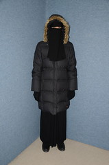 Ready for a hot summer (Buses,Trains and Fetish) Tags: slave waitress maid apron hot winter sweat torture anorak coat fur niqab hijab burka chador girl boots