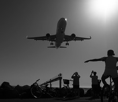 Arrival (Georgie Pauwels) Tags: arrival airplane street lanzarote watching plane candid sunlight streetphotography blackandwhite olympus airport aircraft