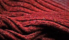 Warm woollen (Explored 03.27.2017) (BreezyWinter) Tags: macromonday clothtextile woolen warm texture warmth wool cloth textile fabric red favoritesweater sweater hmm