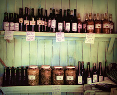 Wine and Salsa (Artypixall) Tags: cuba camaguey market stall shelves wine salsa sauces pickledgoods