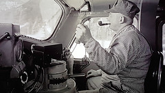 Canadian Pacific Train Driver 1950s. (ManOfYorkshire) Tags: train driver engineer canada canadianpacific railway railroad diesel locomotive cab smoking pipe horn 1950s 1955