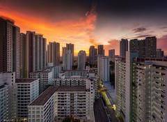Flameblast (Wolfics) Tags: singapore sunset tpy toa payoh pan panorama panning hdb estate building architecture layout orange yellow burn wide uwa sony 1635mm sel1635z 2017