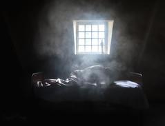 Burning desire (Fragile Decay) Tags: asylum sanatorium empty forbidden forgotten lost burning desire sony window statue smoke selfportrait fragiledecay urban exploring bed dress