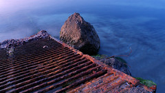 Old And Rusty (Tassos Giannouris) Tags: old rusty jetty rocks sea water long exposure kos greece seascape nature ship sunset