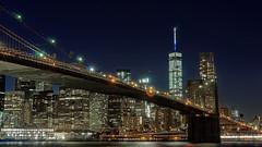 Brooklynite II (iShootPics) Tags: lights night wtc cityscape zeiss bridge river nyc water longexposure east a7 sony landmark brooklyn sel55f18z brooklynbridge eastriver