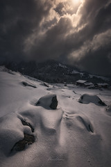 Dark Ice-Queen (Manuel.Martin_72) Tags: graubünden prättigau swissalps switzerland darkmood darkness drama enchanting lightdrama magic mysterious forest mountains rocks stones frozen snow clouds cloudy snowy morning houses pany ch
