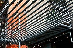 Moire (daphnemir) Tags: christmas street light urban orange building texture geometric lines architecture modern austin photography lights texas arch balcony south optical architect fairy congress illusion tricolor string bulbs sculptural linear festoon