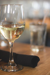 Cheers to the Weekend! (flashfix) Tags: ontario canada glass canon reflections 50mm restaurant soft wine bokeh napkin ottawa wineglass whitewine ambiance woodtable 2014 softexposure 60d cheerstotheweekend moxiesbarandgrill canaon60d 2014inphotos april172014