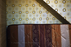 A spare bed under the stairs. (James_at_Slack) Tags: wallpaper abandoned lines yellow cord scotland bed aberdeenshire circles patterns derelict mattress ruraldecay decayed ruralexploration jamesdyasdavidson broadbog