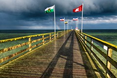 Ist der Mai kuhl und nass..... (dubdream) Tags: ocean wood sea sky cloud seascape beach water rain germany spring rainbow nikon day flag balticsea structure railing ostsee hdr cloudysky schleswigholstein d800 sdstrand colorimage grosenbrode dubdream seebrckegrosenbrode