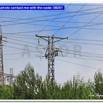 High voltage electrical towers in a green field thumbnail