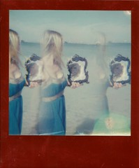 beauty reflected in the ocean (justinvalentine2) Tags: roidweek roidweek2017 impossibleproject luckyeditionfilm spectramultiimagefilter instant instantphotography polaroid polavoid polaroidsx70 sx70 luckyedition imposibleprojectluckyedition clearwaterbeach brittgrimm