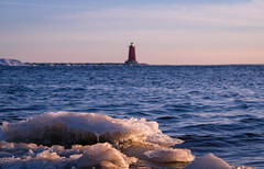 Spring thaw (BryanNewland) Tags: aperture blur ice goldenhour water lake cold lakemichigan lighthouse blue manistique michigan northernmichigan upperpeninsula yooper nature crystal greatlakes